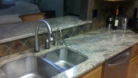 Image Granite Slab with tile backsplash